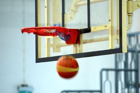 layup: A motion of basketball swishing through the hoop Stock Photo