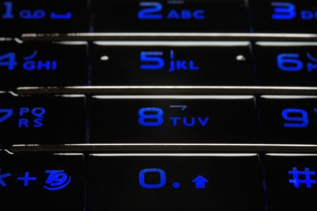 Close up shot of blue mobile keypad under dark environment Stock Photo - 1355914