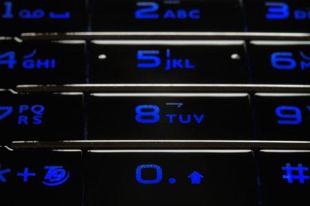Close up shot of blue mobile keypad under dark environment Stock Photo - 1355914