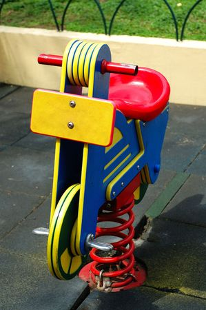 citypark: A colorful toy bicycle at the citypark playground