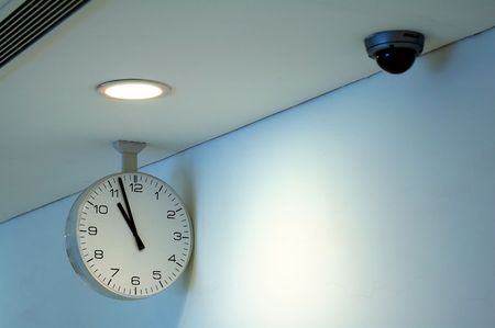 The clock and security camera of corridor ceiling Stock Photo - 1355911