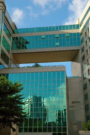 overbridge: The glass wall of a commerical building Stock Photo