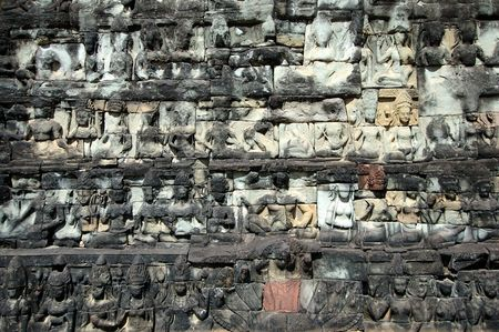 Sculptured buddhas on wall of Terrace of the Elephant, Cambodia Stock Photo - 1778112