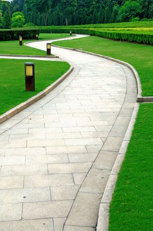 The curvy walk way of a city park
