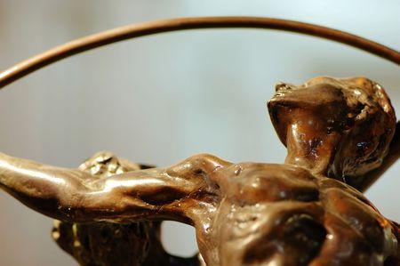 sportman: Close up shot of gymnast (bronze) figurines Stock Photo