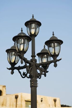 lamplight: Close up of antique street lamp over the blue sky Stock Photo