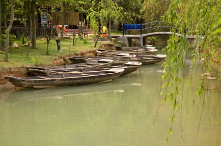 The anchored boats on a river of city park photo