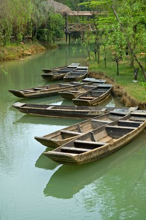 skiff: The anchored boats on a river of city park