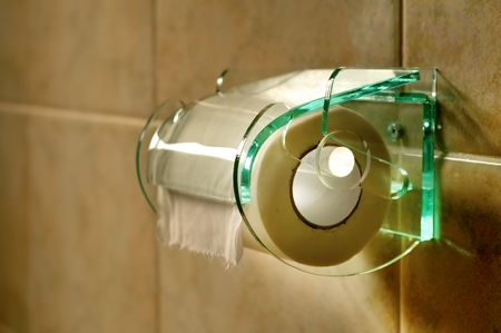 Picture of a simple loo roll on glass holder