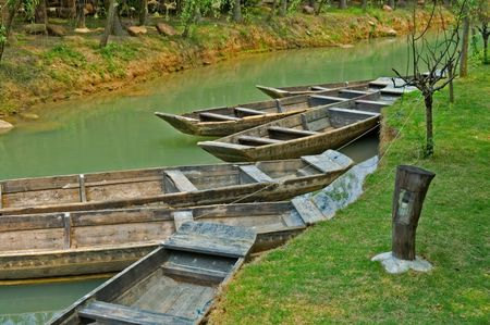The anchored boats on a river in garden photo