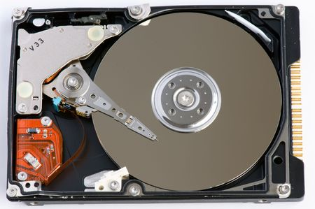 databank: Opened hard disk showing the disk surface and drive head
