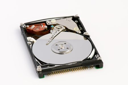 Opened hard disk showing the disk surface and drive head