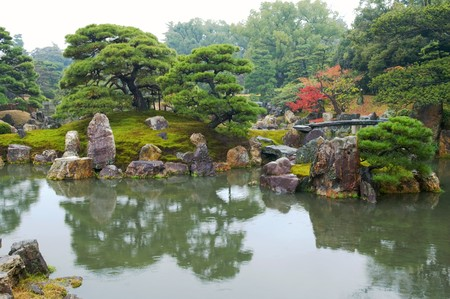 japanese fall foliage: Beautiful Japanese garden with trees and pond