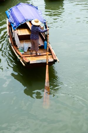 boat house: The view of water town in China, with boat man rowing on river Stock Photo