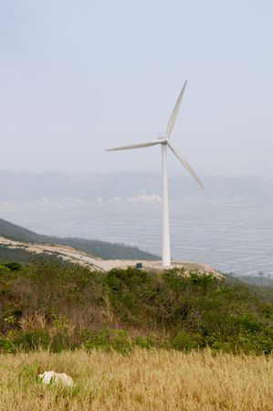 White electrical power generating wind turbines on rolling hills Stock Photo - 5912788