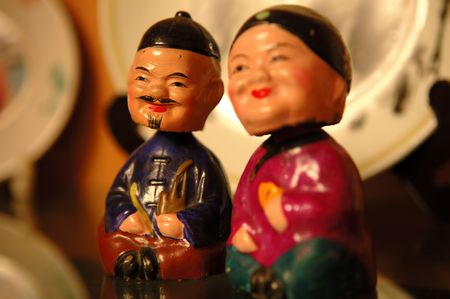 The close up of Chinese old couple figurines photo