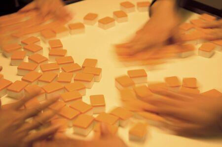People playing mahjong on a table photo