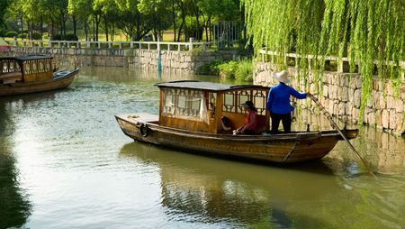 zhouzhuang: The view of water town in China, with boat man rowing on river Stock Photo