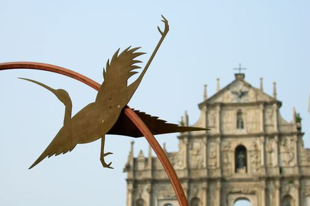 Statue of egret and Ruins of St Pauls Cathedral, Macau   photo