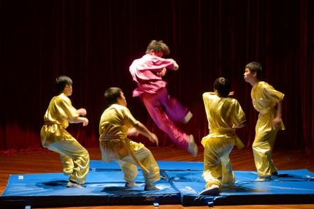 shu: MACAU - APRIL 25: Performing Chinese kung fu (wu shu) with pose of kicking enemies, April 25, 2009, Macau, China Editorial