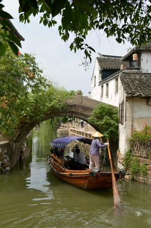 zhouzhuang: The view of water town in China, with boat man rowing on river Editorial