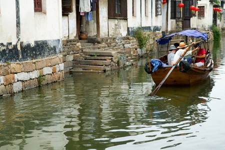 The view of water town in China, with boat man rowing on river Stock Photo - 7959721