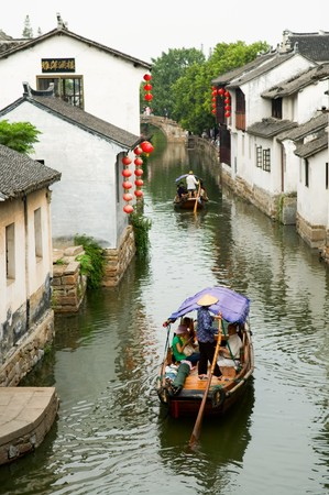 The aerial view of water town in China, with boat man rowing on river