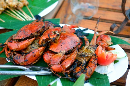 Fried crabs traditional asian cuisine restaurant setting     Stock Photo