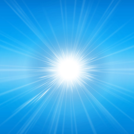 Radiant sunshine. Intense sunlight and sunbeams in a clear blue sky Stock Photo