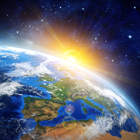 Imaginary view of planet earth in outer space with the rising sun. 版權商用圖片 - 36890182