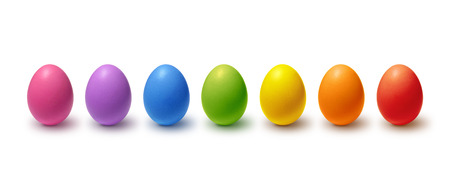 Rainbow colored Easter eggs isolated on white