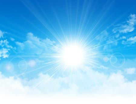sol radiante: La luz del sol rompiendo nubes blancas en el cielo azul