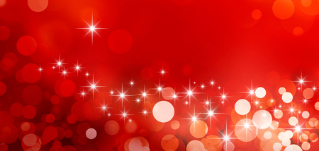 星の光と輝きに光沢のある赤い背景