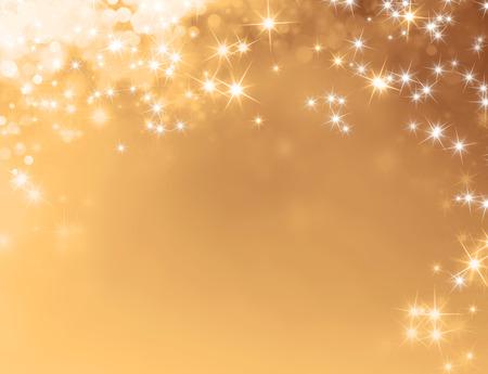 Glanzende gouden achtergrond met sterrenlicht regent Stockfoto