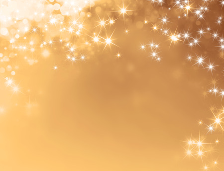 Shiny gold background with starlight raining down Stock Photo