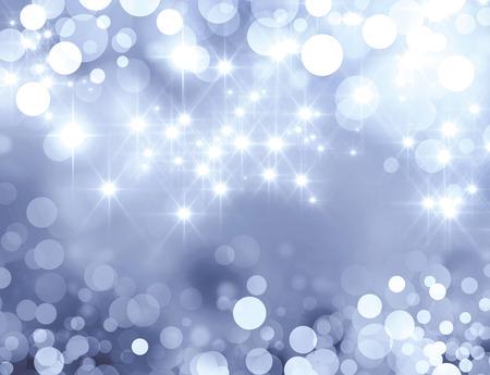星の光と輝く光沢のあるシルバーの背景