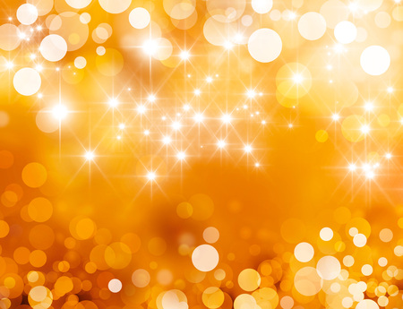 Shiny gold background in starlight and sparkles