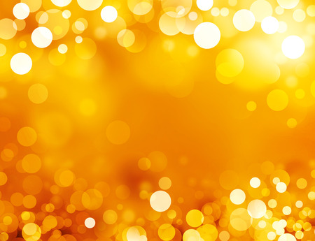 Shiny gold background in sparkles Imagens