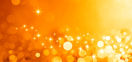 スターライトと輝きの光沢のあるゴールドの背景 写真素材