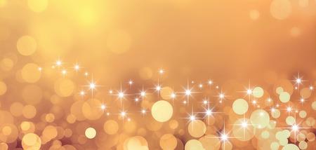 星光と輝きで光沢のあるゴールドの背景 写真素材