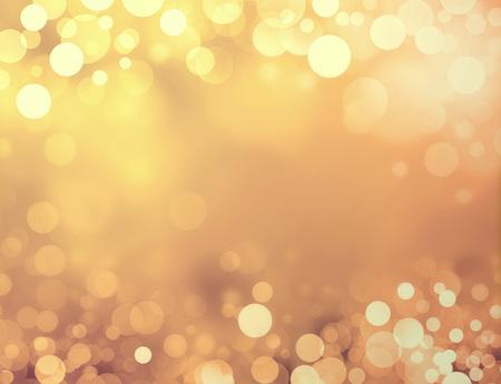 慶典: 閃亮的金色背景模糊的圓圈和火花