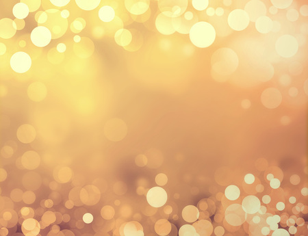 holiday celebration: Shiny gold background with blurry circles and sparkles