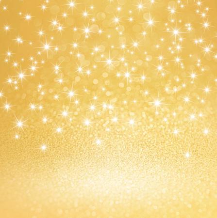 Shiny stars on glitter gold background