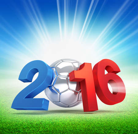 victorious: 2016 year French flag colored, illustrated with a silver soccer ball and illuminated on a grass field
