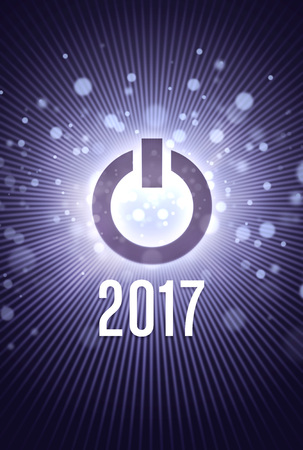 power button: 2017 new year starting in light with a power button Stock Photo