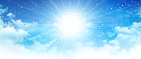 Shining sun breaking through white clouds in early morning blue sky, deep space and bright stars behind.