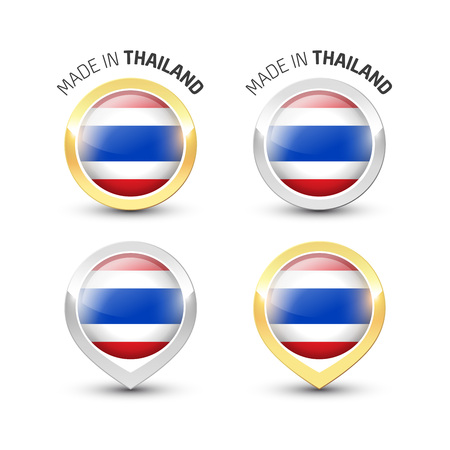 Made in Thailand - Guarantee label with the Thai flag inside round gold and silver icons. Reklamní fotografie - 119792992