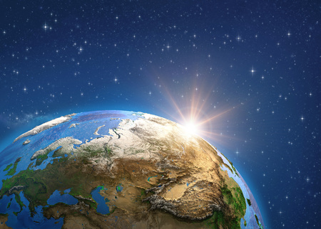 Planet Earth in deep space, focused on Europe and Asia, sun shining on the horizon. Reklamní fotografie - 123216828