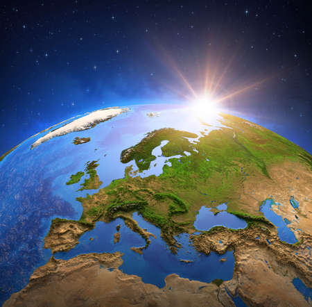 Surface of the Planet Earth viewed from a satellite, focused on Europe, sun rising on the horizon. Physical map of European countries. 3D illustration