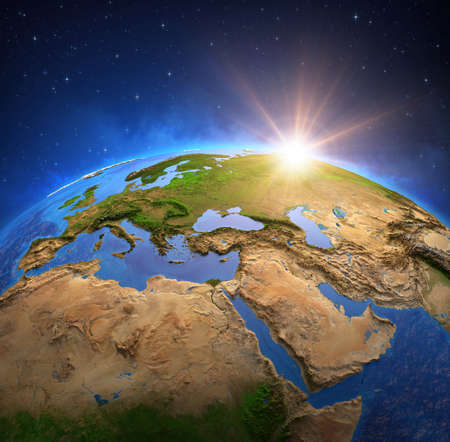 Surface of the Planet Earth viewed from a satellite, focused on Europe and Middle East, sun rising on the horizon. Physical map of the World. 3D illustration
